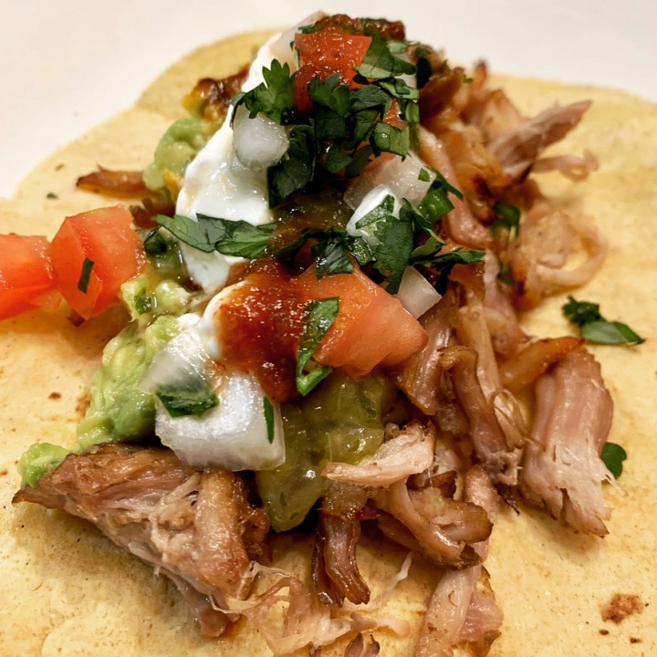 Sous vide carnitas tacos with charred salsa verde